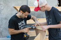 Tony Gareri building a bench with Roma Wish Team member Isaiah.