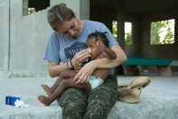 Tania caring for a young Haitian girl at HATS home base.