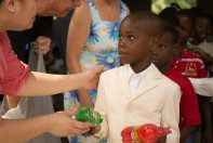 A Haitian boy getting his treat after Sunday church service.