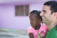 Roma Moulding CEO Tony Gareri with a young Haitian girl.