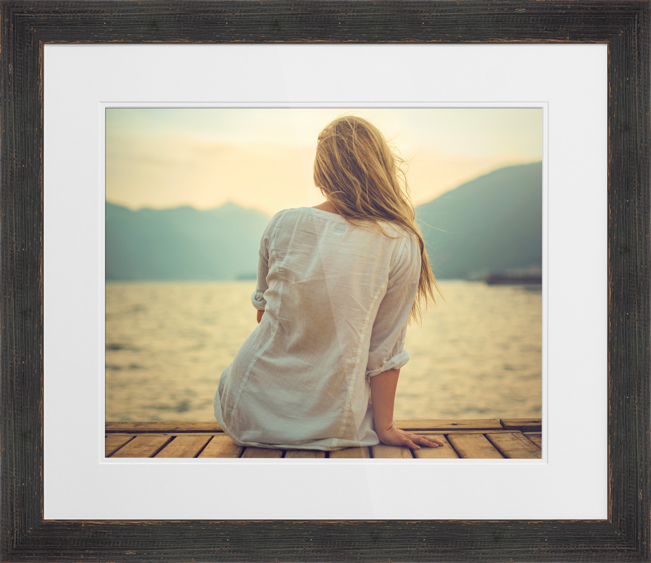 2016-Summer-Launch-Girl-Sitting-On-A-Dock-Watching-At-A-Lake